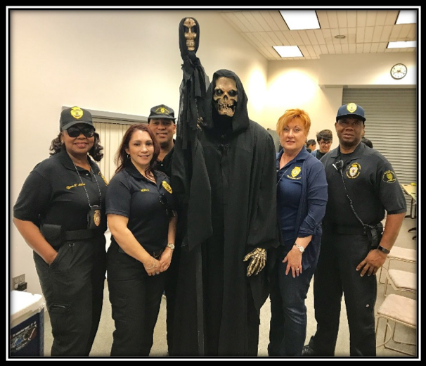 Picture of Probation Officers with a fake grim reaper.
