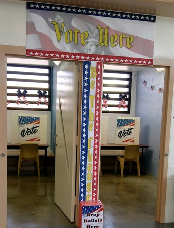 Probation staff members set up a voting booth at Barry J. Nidorf Juvenile Hall